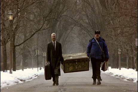 Neal Page and Del Griffith carrying Del's trunk