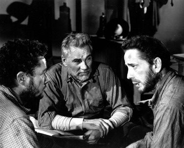 Tim Holt, Walter Huston and Humphrey Bogart as Curtin, Howard and Fred C. Dobbs